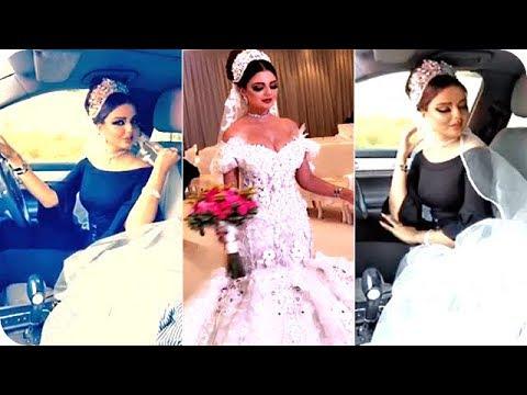 شاهد عارضة أزياء تسوّق سيارتها بفستان الزفاف