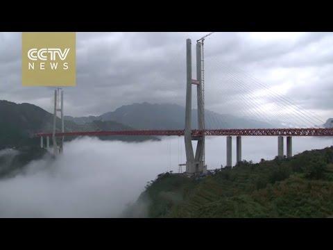لمسات البناء الأخيرة لأعلى جسر في العالم